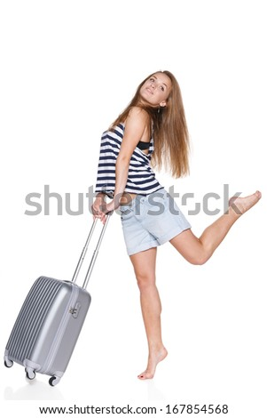 Excited teenager hipster with travel suitcase in full length looking to the side,  isolated on white background - stock photo