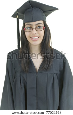 Excited Teenager with glasses wearing cap and gown celebrates because she  graduates