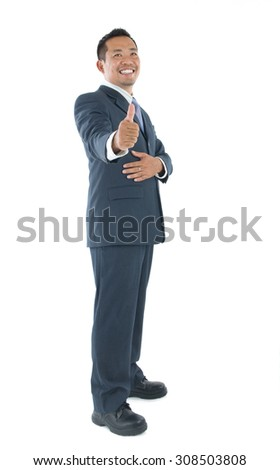 Excited thumb up 40s Indonesian businessman in black suit isolated on white background - stock photo