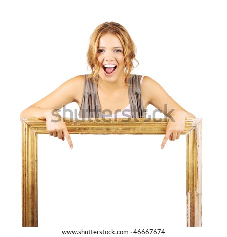 Excited woman holding frame and pointing to the blank sign inside - stock photo
