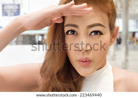 excited woman looking at you - stock photo
