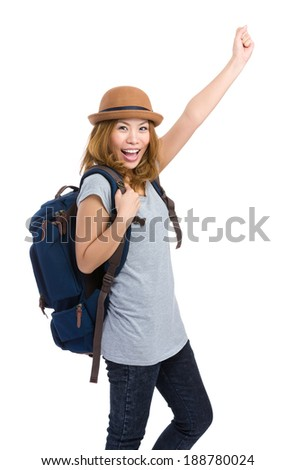 Excited woman with backpack