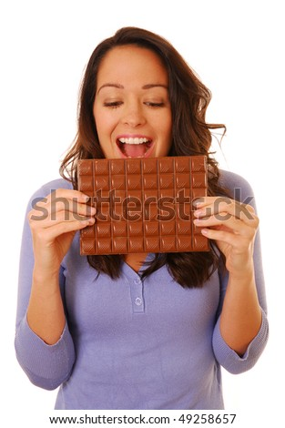 Excited woman with chocolate - stock photo
