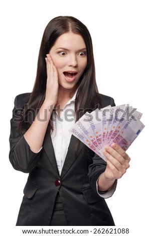 Excited woman with euro money in hand. Surprised business woman looking with excitement at money, over white background  - stock photo
