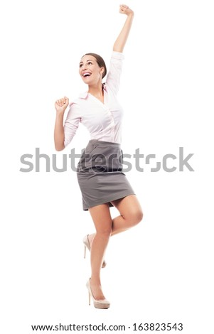 Excited woman with fists clenched