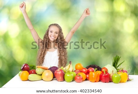 Excited woman with fruits and vegetables.