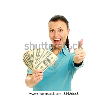Excited woman with handful of money giving thumbs up isolated on white background - stock photo
