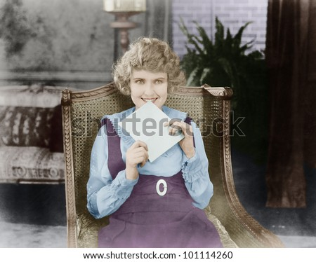 Excited woman with letter - stock photo