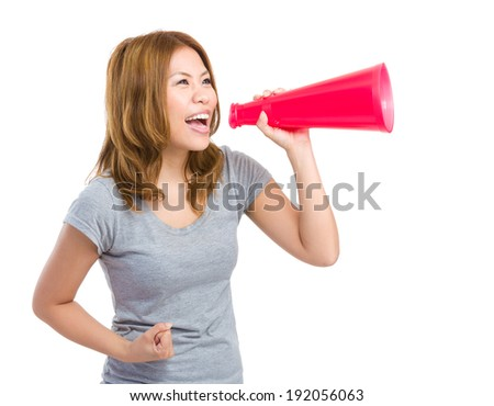 Excited woman yelling with megaphone