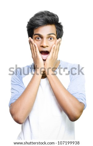Excited young Asian man with hands to face and surprised expression on white background