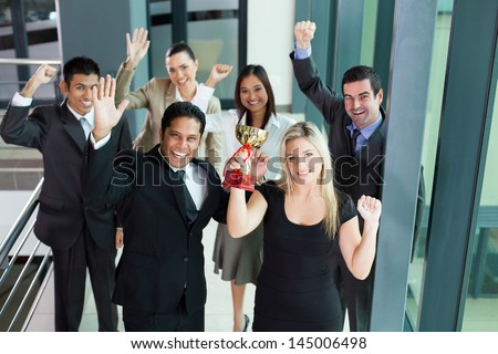 excited young business people winning a trophy - stock photo