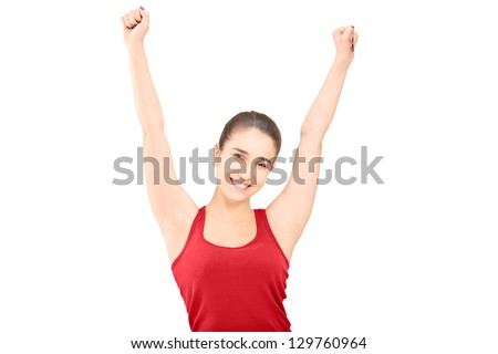 Excited young female gesturing happiness isolated on white background