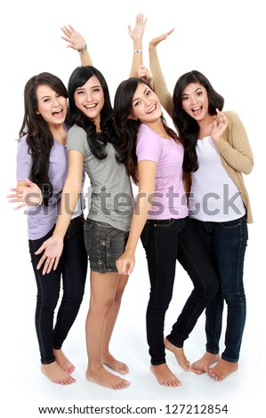 excited young happy woman group raise their hands together - stock photo