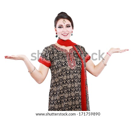 Excited young Indian woman against white background - stock photo
