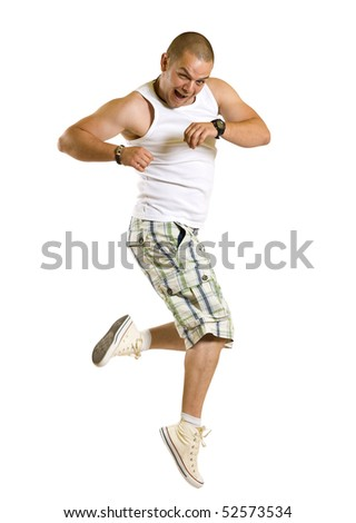 Excited young man jumping and smiling isolated on white