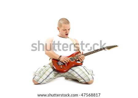 excited young man playing a guitar isolated against white background