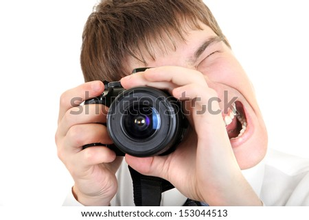 Excited Young Man Take a Picture with a Camera Isolated on the White Background