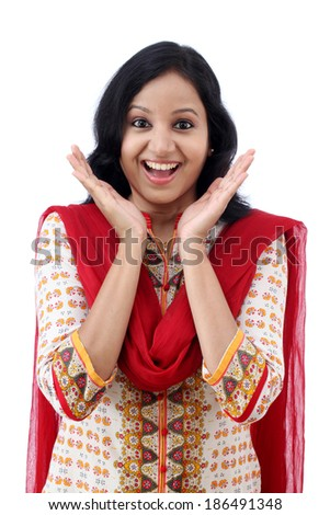Excited young woman against white background - stock photo