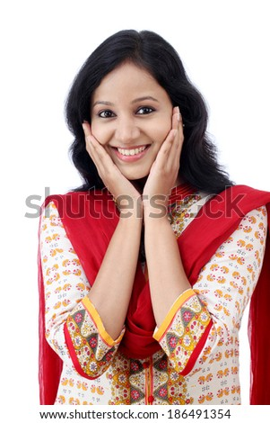 Excited young woman against white background