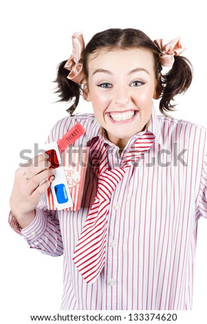 Excited young woman holding popcorn, cinema ticket and 3D movie glasses - stock photo