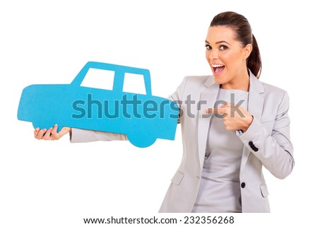 excited young woman pointing blue car symbol - stock photo