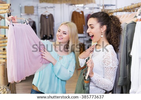 Excited young woman shopping jersey at the apparel store