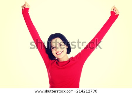 Excited young woman with fists up, isolated - stock photo