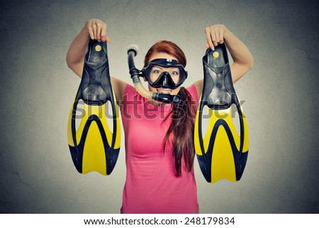 Excited young woman with snorkel equipment isolated on grey wall background  - stock photo