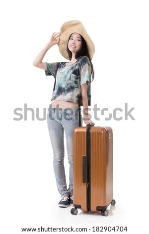 Exciting Asian woman drag a luggage, full length portrait isolated on white background. - stock photo