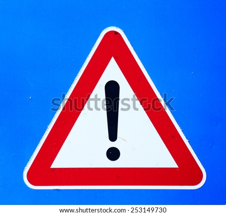 exclamation mark sign on blue background - stock photo
