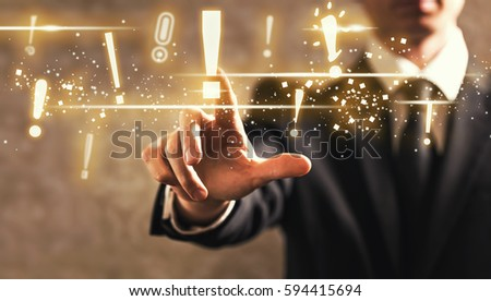 Exclamation Mark with businessman on dark vintage background