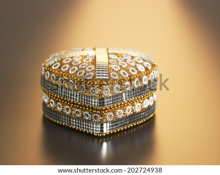 exclusive jewel box on the warm color background - stock photo