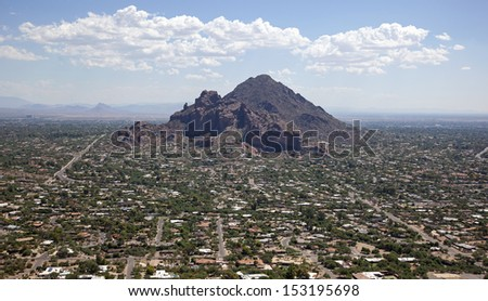 Exclusive living in the area of Camelback Mountain in Phoenix, Arizona as viewed from the air looking east