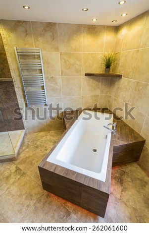 Exclusive marble bathtub in modern bathroom - stock photo
