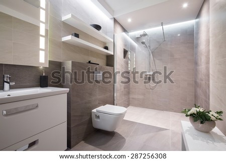 Exclusive modern white bathroom with glass shower - stock photo