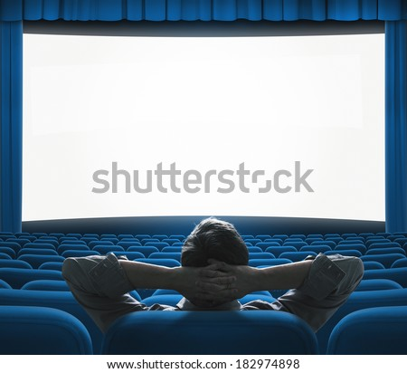 Exclusive movie preview on big screen. Blue VIP cinema auditorium. Art house concept. - stock photo