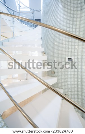 Exclusive spiral stairs in modern house - stock photo