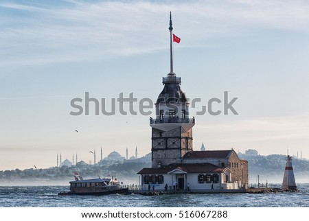 excursion tourist ship swims up to the Maiden tower in Istanbul