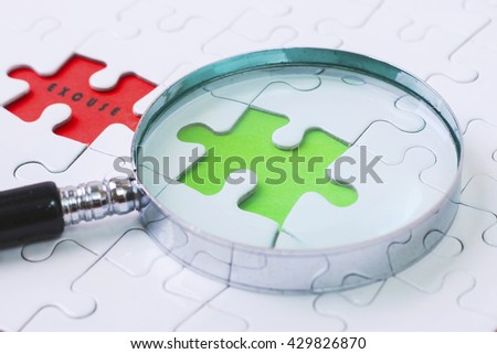EXCUSE puzzle with magnifier glass - stock photo