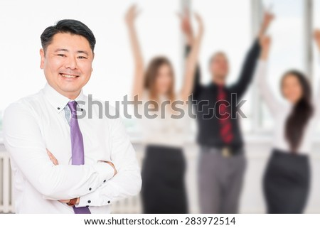 Executive asian boss with his successful business team at background. Multiracial people is a good addition for running a successful business - stock photo