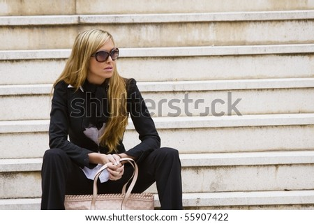 Executive beautiful woman, waiting at the stairs - stock photo