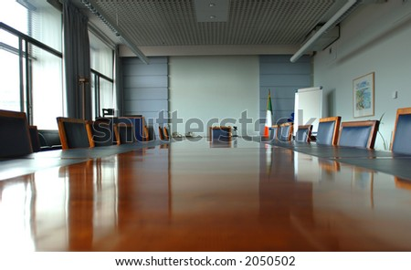 Executive Boardroom with mahogany table centre - stock photo