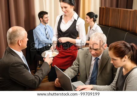 Executive business man pay restaurant bill during management meeting