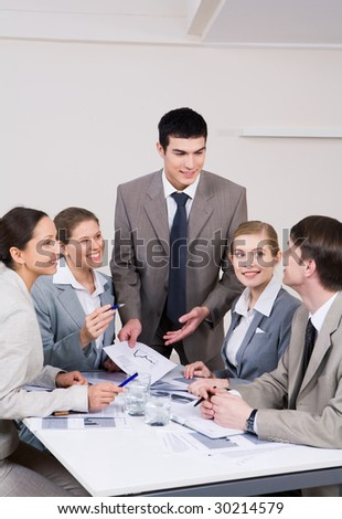 Executive business partners looking at each other and planning their work - stock photo