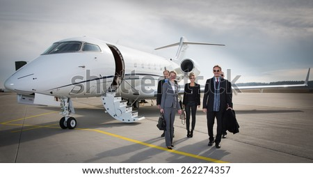 Jet stock images royalty free images vectors shutterstock executive business team leaving corporate jet malvernweather Choice Image