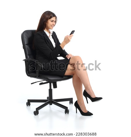 Executive business woman using a smart phone sitting on a chair isolated on a white background - stock photo