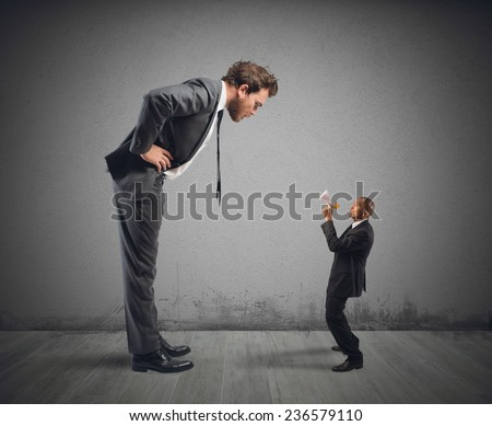 Executive businessman accuses one of his employees - stock photo