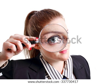 Executive girl with magnifying glass