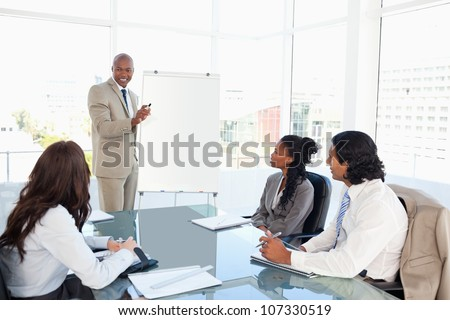 Executive giving a presentation in front of his co-workers