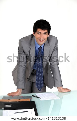 Executive hands resting on table - stock photo